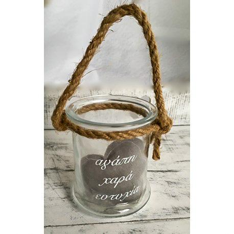 Χειροποίητη βαφτιστική μπουμπουνιέρα γυάλινο μπουκάλι με ελληνικές ευχές και χοντρό σκοινί. Διαστάσεις: Ύψος 10 cm x Μήκος 8,5 cm.