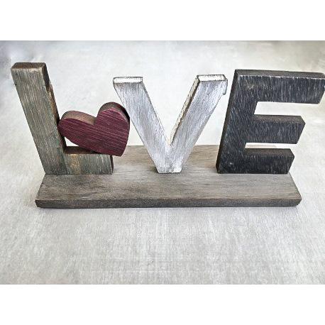 Χειροποίητη βαπτιστική μπομπονιέρα ξύλινο LOVE με καρδούλα  Χειροποίητη βαφτιστική μπουμπουνιέρα ξύλινο LOVE με καρδούλα. Διαστάσεις: Ύψος 6 cm x Μήκος 15 cm.