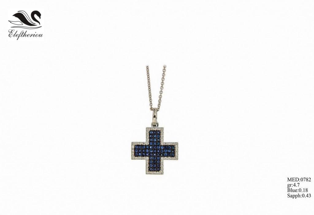 Βαπτιστικός σταυρός  06 για κορίτσι 4,7 γραμμαρίων σε λευκό χρυσό με λευκά μπριγιάν 18 εκατοστών του καρατίου (περιμετρικά τοποθετημένα) και μπλε μπριγιάν 43 εκατοστών του καρατίου