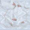 Ρομαντικά στέφανα γάμου από ροζ λουλούδια πορσελάνης, σε πολυτελή θήκη.